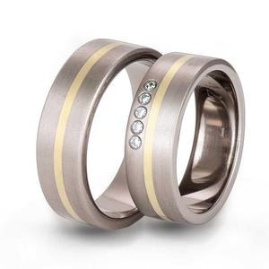 Obrączka z tytanu i zółtego złota z kamyczkami TG42 - 2824437807