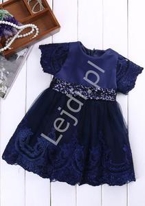 2a0b6be104 Granatowa sukienka dla dziewczynki zdobiona koronką i cekinową kokardą -  2878188536