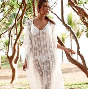 dd4acf0fd0 Długa koronkowa sukienka plażowa . Kolor biały P144 - 2880378036